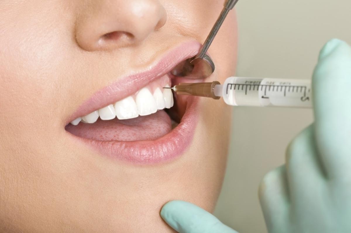После анестезии зуба болит голова